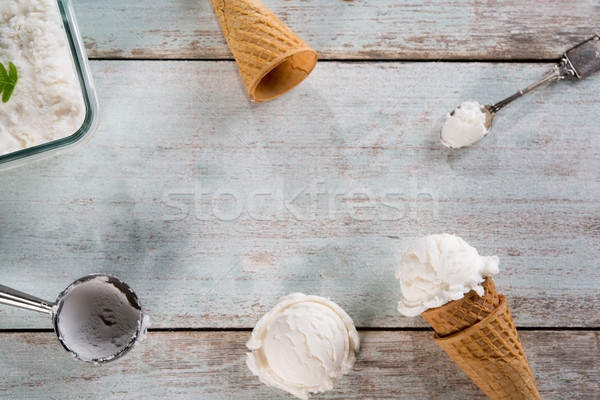Vanilla ice cream wafer cone  Stock photo © szefei