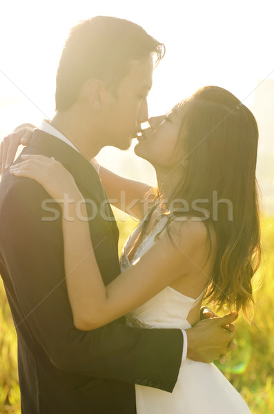 Bride and groom kissing Stock photo © szefei