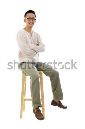 Egészalakos ázsiai férfi ül szék fehér Stock fotó © szefei