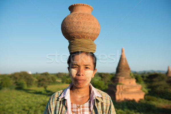 Portrait of Asian traditional farmer carrying pot on head Stock photo © szefei