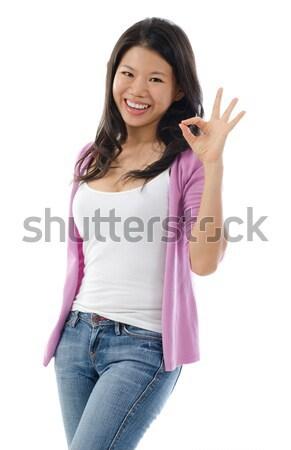 ázsiai nő mutat oké kézjel fiatal Stock fotó © szefei