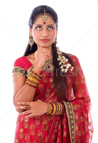 Indian girl thinking Stock photo © szefei