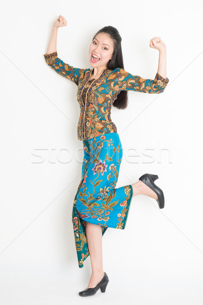 Asian girl jumping around Stock photo © szefei