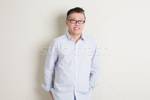 Stockfoto: Portret · volwassen · asian · man · 50s · toevallig