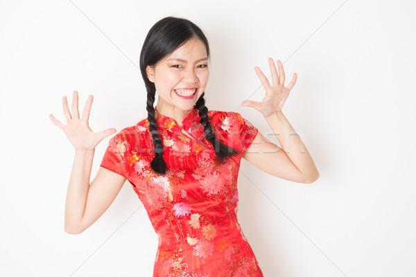 Oriental girl in red qipao surprised Stock photo © szefei