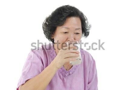 Senior mulher potável leite vidro retrato Foto stock © szefei