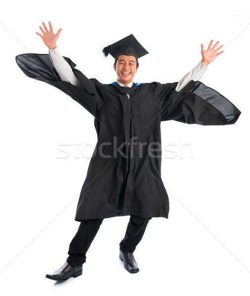 Afstuderen springen opgewonden asian Stockfoto © szefei