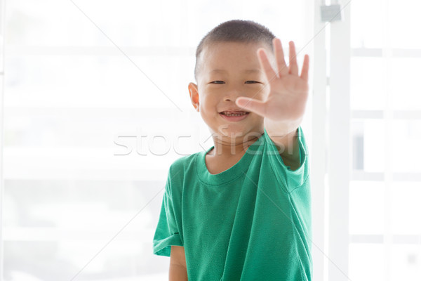 Playful boy showing high five Stock photo © szefei