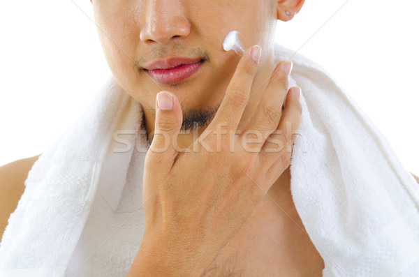 Man applying lotion Stock photo © szefei