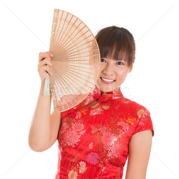Chinese cheongsam woman with fan Stock photo © szefei