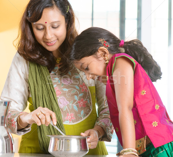 Indian family cooking at home. Stock photo © szefei