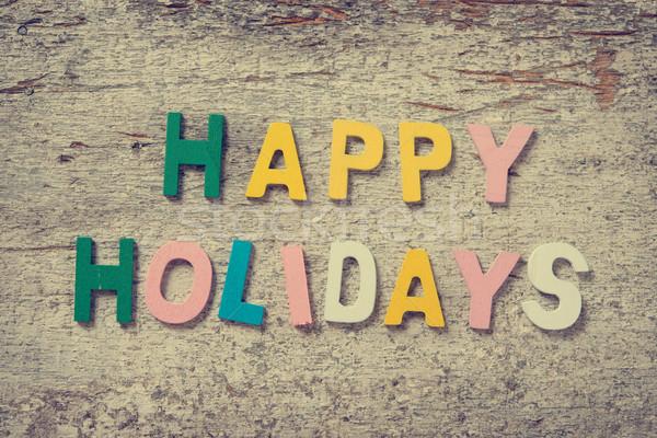 Foto d'archivio: Felice · vacanze · parole · vecchio · legno