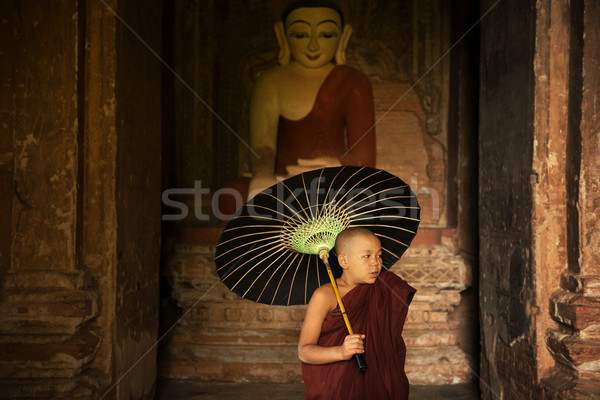 Buddhist novice monk inside monastery Stock photo © szefei