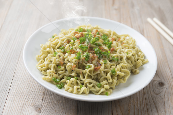 Dried noodles plate Stock photo © szefei