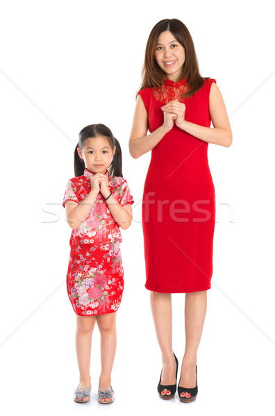 Full body Chinese parent and child greeting to each other Stock photo © szefei