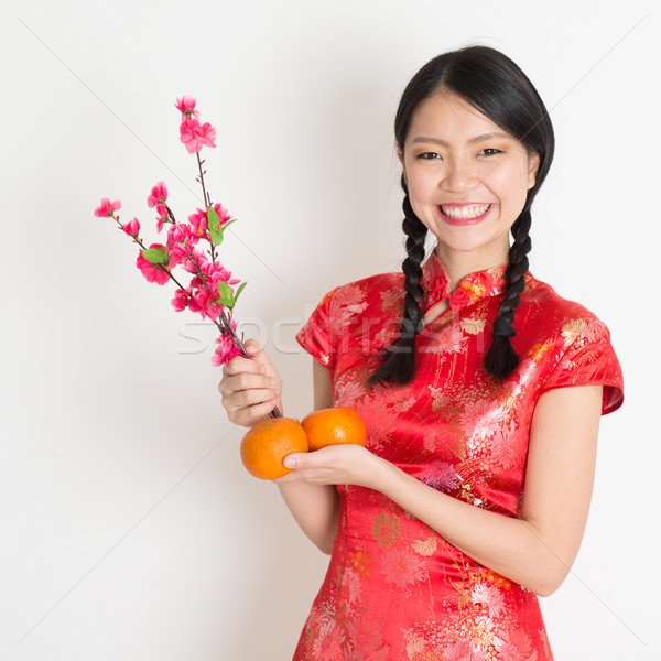 Asian chinese girl holding tangerine and plum blossom Stock photo © szefei
