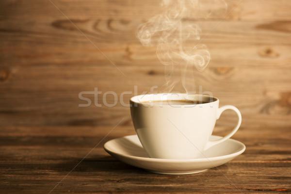 Steaming hot coffee in white mug Stock photo © szefei