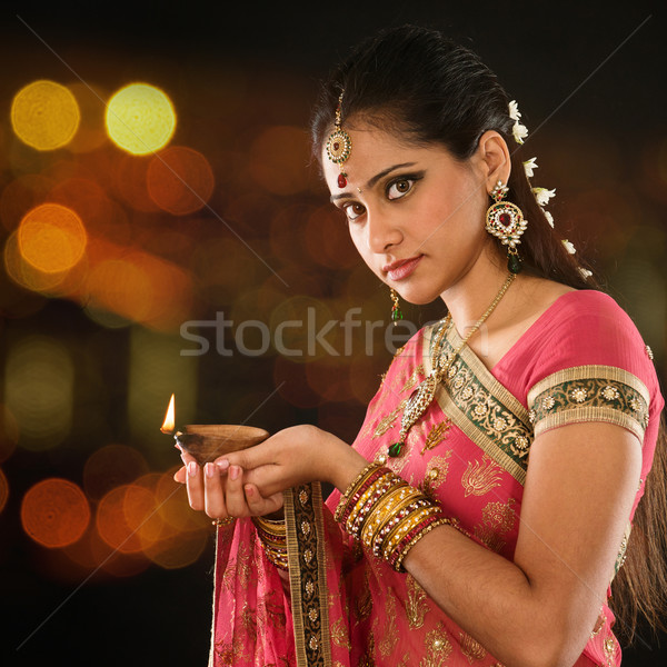 Indian girl hands holding diya lights Stock photo © szefei