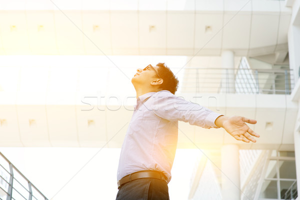 Asian Indian businessman arms outstretched  Stock photo © szefei