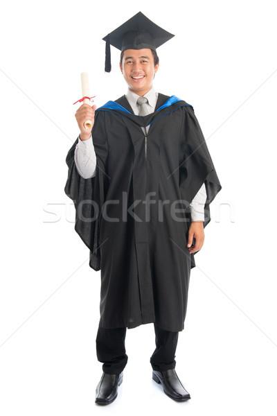 Teljes alakos egyetemi hallgató érettségi portré egészalakos férfi Stock fotó © szefei