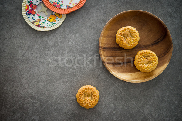 Mid-Autumn Festival Moon cakes with copy space on low light back Stock photo © szefei