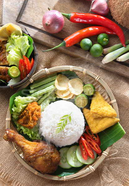 Nasi ayam penyet Stock photo © szefei