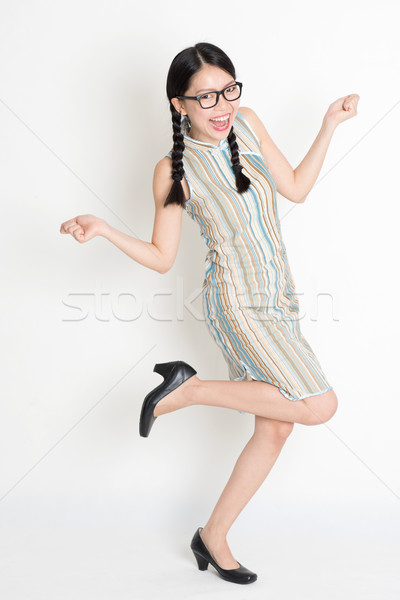 Excited Asian Chinese female hands holding something  Stock photo © szefei