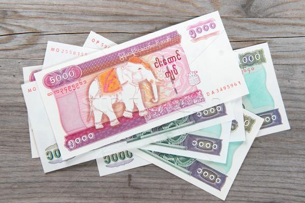 Myanmar banka notlar ahşap masa tablo finanse Stok fotoğraf © szefei