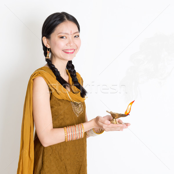 Woman holding diya light Stock photo © szefei