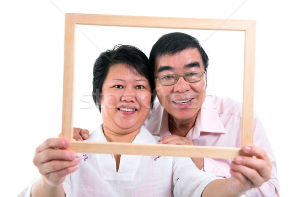 Délkelet ázsiai pár mosolyog öreg néz Stock fotó © szefei
