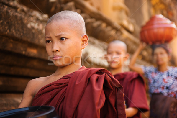 Southeast Asian young Buddhist monks walking morning alms Stock photo © szefei