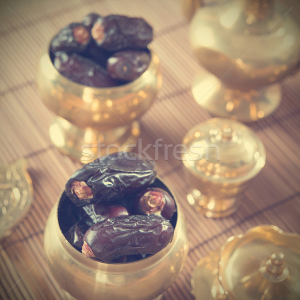 Dried date palm fruits, kurma Stock photo © szefei