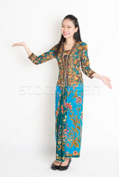 Asian girl showing something Stock photo © szefei