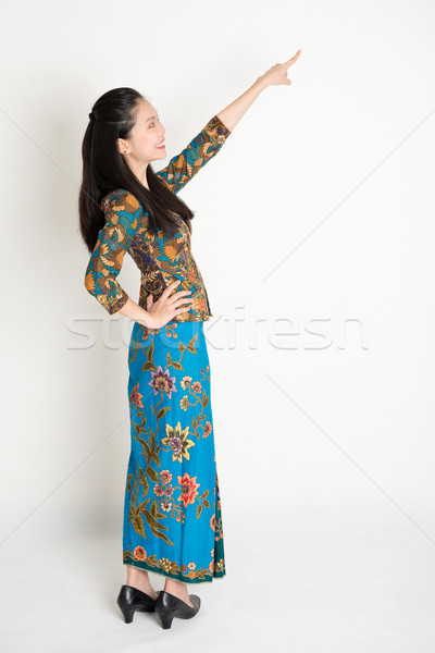 Asian female pointing Stock photo © szefei