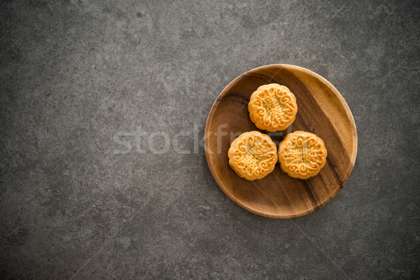 Mid-Autumn Festival Mooncakes with copy space on low light backg Stock photo © szefei