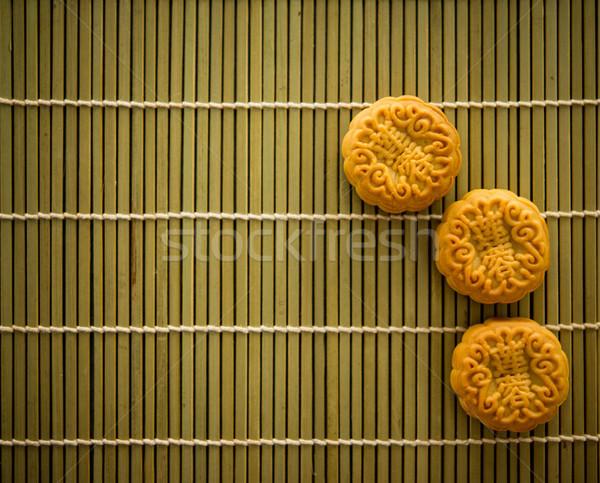Mooncakes on bamboo mat dark light with copy space  Stock photo © szefei