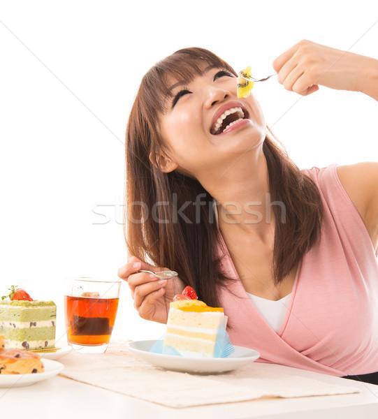 Eating cakes Stock photo © szefei