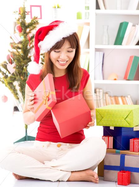 Peeking inside Christmas gift Stock photo © szefei