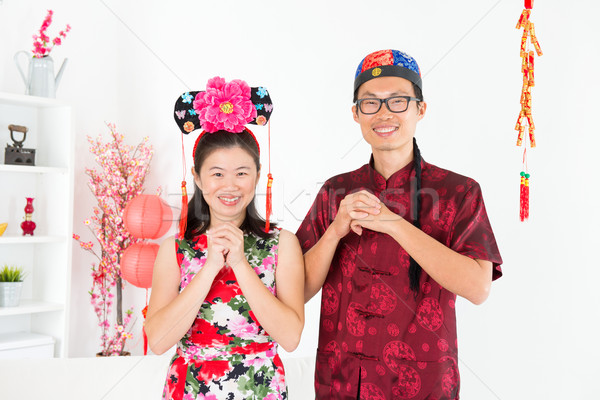 Asian people blessing during Chinese New Day Stock photo © szefei
