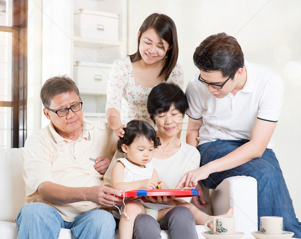 Grandparents having fun with offsprings Stock photo © szefei