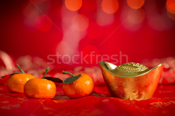 Chinese New Year decorations gold ingot and mandarin orange Stock photo © szefei