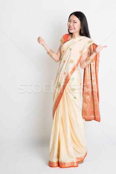 Woman in Indian sari dress thumbs up Stock photo © szefei