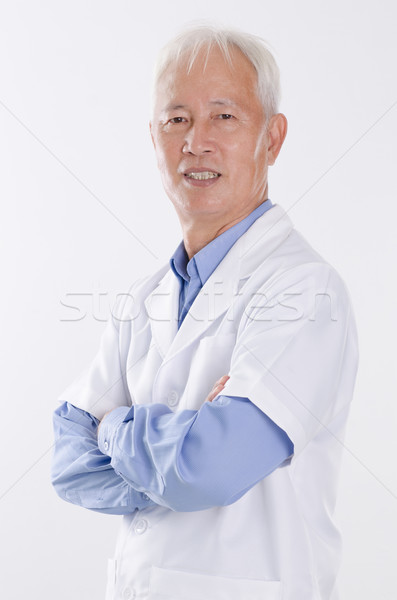 Old man in lab coat Stock photo © szefei