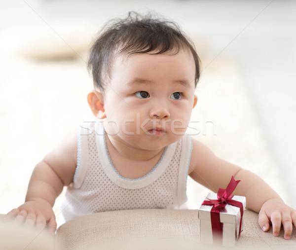 Baby learning to walk. Stock photo © szefei