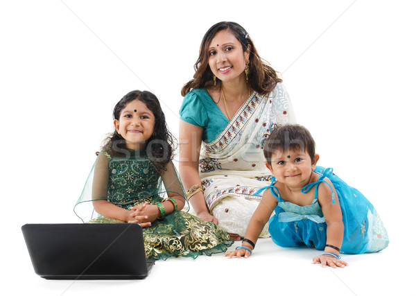 Traditional Indian family with laptop Stock photo © szefei