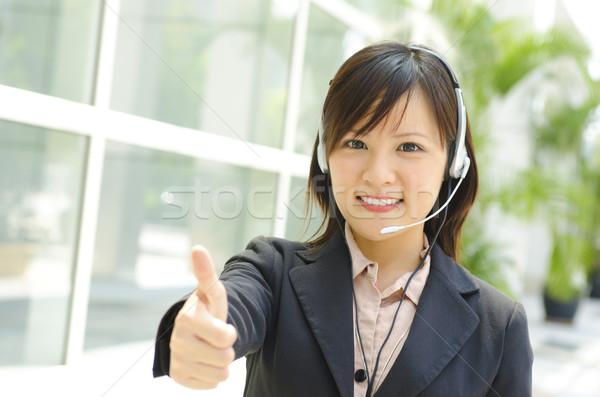 拇指 上 顧客 代表 友好 耳機 商業照片 © szefei
