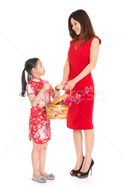 Chinese family holding a gift basket Stock photo © szefei