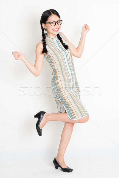 Excited Asian woman jumping around Stock photo © szefei
