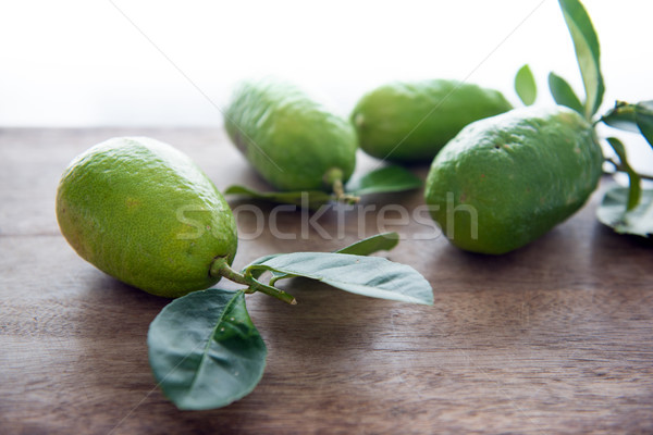 Fresg organic green lemons with leaves Stock photo © szefei