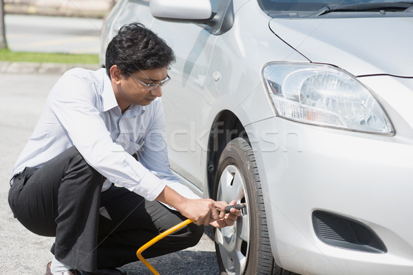 Indian people filling air to the car tires. Stock photo © szefei